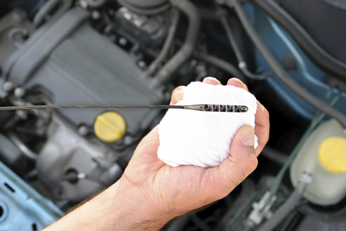 Signs Your Car Needs An Oil Change on transmission fluid dipstick reading