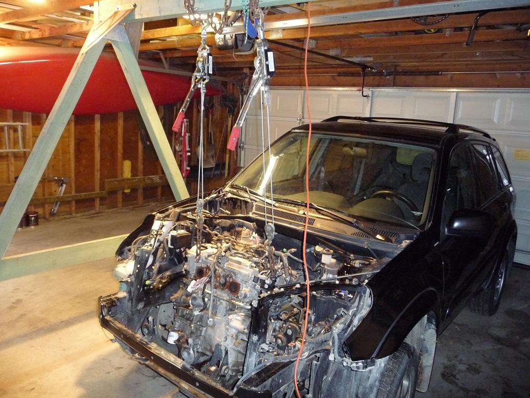 car engines about to be removed from the car using a swingset