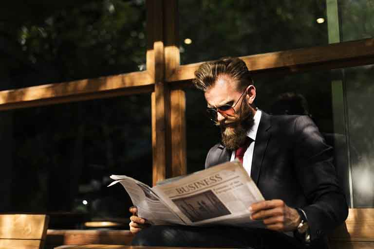 salesman reading a newspaper