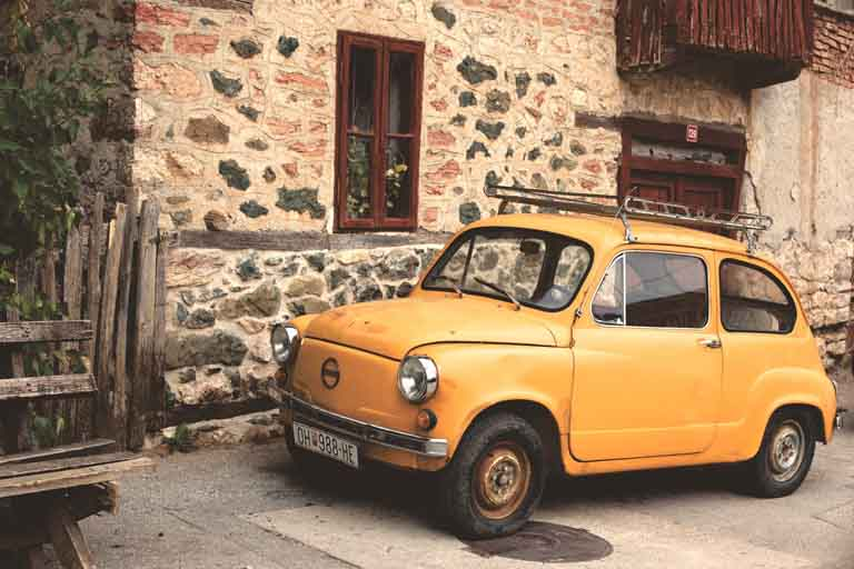 a yellow orange 1983 Zastava 750 vintage car