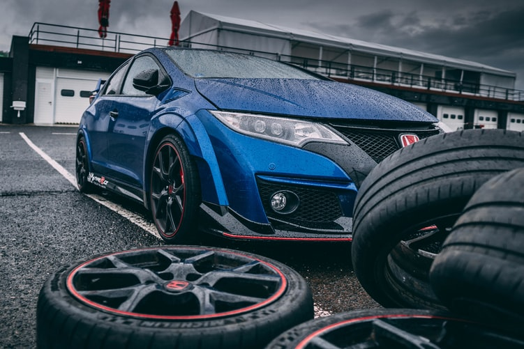 blue Honda vehicle patching a tire