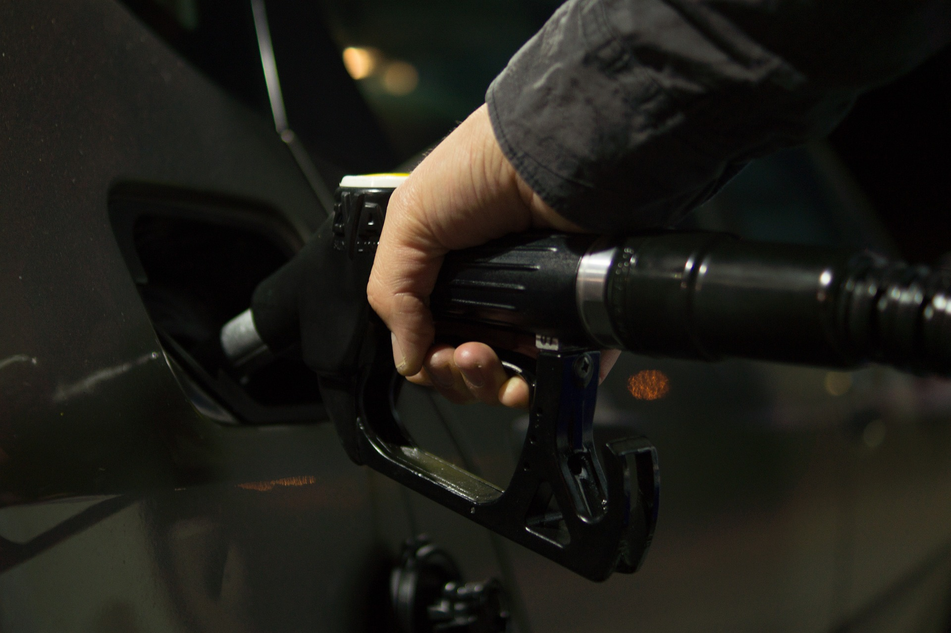 A person is fueling the car with gas